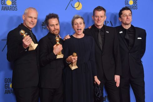 Director Martin McDonagh, Sam Rockwell, Frances McDormand, Graham Broadbent and Peter Czernin pose with the award for best picture.  Photograph: Frederic J. Brown/AFP/Getty Images