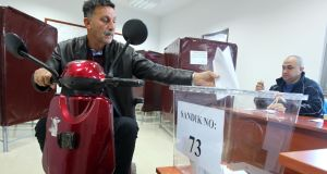 A Turkish Cypriot man casts his ballot for the parliamentary election at a polling station in the self-proclaimed Turkish Republic of Northern Cyprus, which is only recognised by Turkey. Photograph: Birol Bebek/AFP/Getty