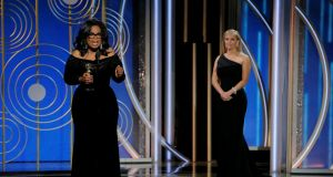 Oprah Winfrey speaks after accepting the Cecil B DeMille Award on Sunday. On Monday the airwaves and TV talk shows were alight with speculation about whether she would consider a presidential run. Photograph: Paul Drinkwater/Courtesy of NBC