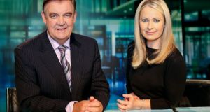 Bryan Dobson and Sharon Ní Bheoláin marking the 25th year of the Six One News programme in 2013.