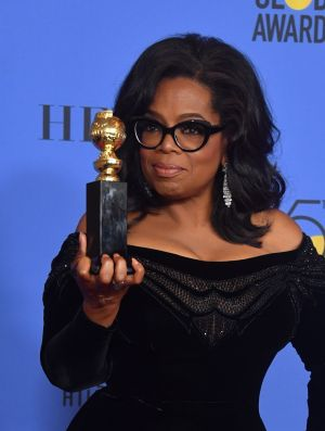 EYES ON THE PRIZE: TV talk show host Oprah Winfrey received the honorary Cecil B DeMille Award for outstanding contributions to the world of entertainment during the 75th Golden Globe Awards in Beverly Hills, California. Some have interpreted her acceptance speech as a pitch for the US presidency. Photograph: Frederic J Brown/AFP/Getty Images