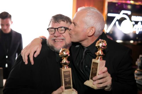 CELEBRATIONS: Golden Globe winners Guillermo del Toro (best director) and Martin McDonagh (best screenplay) celebrate at the after party of the awards. Photograph: Greg Doherty/Getty Images