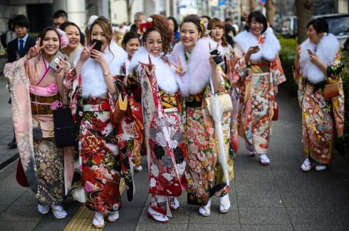 ALL GROWN UP: Women leave a Coming of Age ceremony in Yokohama, Japan. Coming of Age Day is a Japanese holiday held every January to celebrate people who have reached 20 - the official age of adulthood in Japan. Photograph: Carl Court/Getty Images