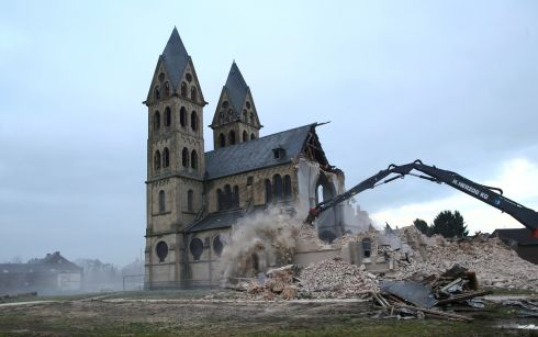 OUT WITH THE OLD: The St Lambertus church in the village of Immerath is demolished for the expansion of the nearby opencast brown coal mine of German power supplier RWE in Germany. Photograph: Wolfgang Rattay/Reuters