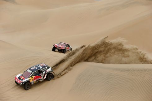 LEFT IN THE DUST: Spanish pair Carlos Sainz and Lucas Cruz  pull away from French team-mates Cyril Despres and David Castera during the Dakar Rally. Photograph: Andres Stapff/Reuters