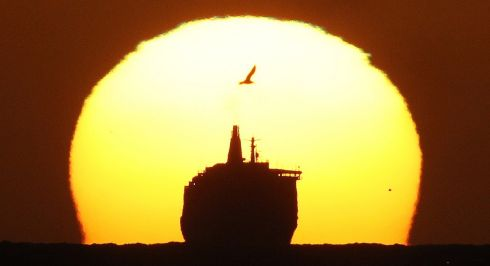 SEA OF OPPORTUNITY: The DFDS King Seaways, travelling across the North Sea, is silhouetted by the rising sun as the 161m long cruise ferry arrives at Tynemouth. Photograph: PA Wire