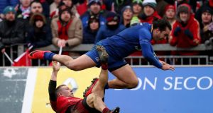 Andrew Conway impedes Leinster's James Lowe, leading to a penalty try and a yellow card against the Munster player during the Pro14 game at Thomond Park on St Stephen's Day. Photograph: Billy Stickland/Inpho