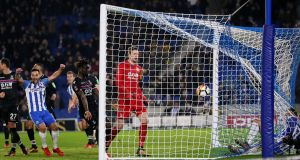 Brighton's Glenn Murray ends up in the back of the net after scoring the winning goal in in the FA Cup third-round tie against Crystal Palace at the Amex Stadium. Photograph: David Klein/Reuters