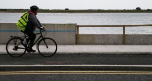 After a dispute with local residents, Dublin City Council agreed to reduce the height of the seafront wall by up to 30cm along almost half a kilometre opposite St Anne's Park. Photograph: Nick Bradshaw
