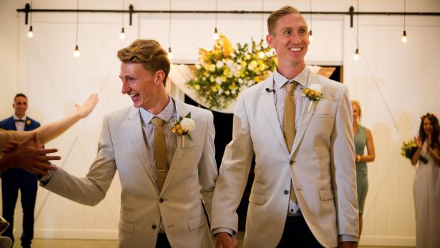 Australian Commonwealth Games sprinter Craig Burns (R) and fiancé Luke Sullivan (L) are congratulated by friends after exchanging vows at their marriage ceremony at Summergrove Estate, New South Wales. Photograph: Patrick Hamilton/EPA