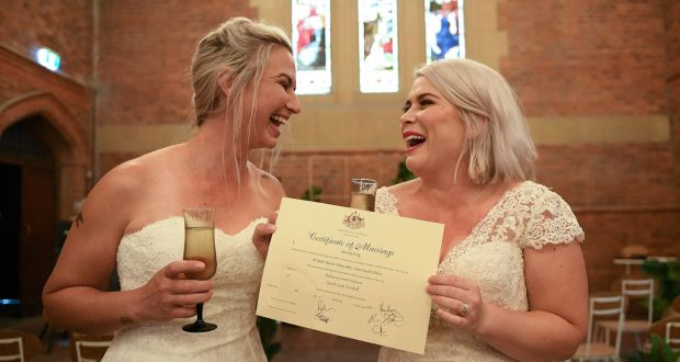 Sarah Turnbull (L) and Rebecca Hickson pose for a photograph with their Certificate of Marriage. Photograph: Dan Himbrechts/EPA