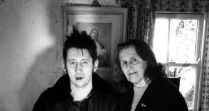 Shane MacGowan with his mother, Therese, at the family home in Ireland, 1997. Photograph: Martyn Goodacre/Getty Images