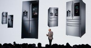 Samsung's Joseph Stinziano talks about the new Family Hub smart refrigerators during a news conference at CES 2018.
