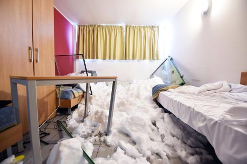 A room covered with snow after an avalanche hit the Olympic Village of Sestriere, Italy. Photograph: Alessandro di Marco/EPA
