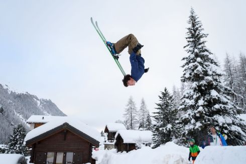 A teenager produces a backflip on skis in the small resort of Zinal, Swiss Alps, after the access road which was cut by heavy snowfall reopened. Photograph: Fabrice Coffrini/Getty Images