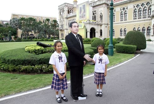 Children next to a cardboard cutout of Thailand's prime minster Prayuth Chan-ocha at government house in Bangkok. Photograph: Dailynews via Reuters