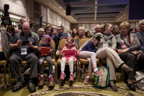 Garrett Cain, and from left, his daughters Elizabeth Cain (5) Madeline Cain (6) and Holly Marie Cain and his wife Ann Marie Cain, all of Rockford, Illinois, wait for US president Donald Trump to address a gathering of farmers and ranchers at the annual American Farm Bureau Federation convention in Nashville, Tennessee. Photograph: Rick Musacchio/EPA