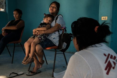 March 2017 - A woman rests with her granddaughter during an MSF support session for women in a shelter for migrants in Tenosique, Mexico. According to an MSF survey, nearly one-third of women migrating through Mexico suffer sexual abuse.  Photograph: Marta Soszynska/ MSF