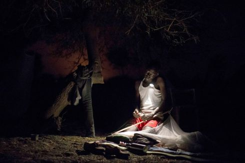 March 2017- James, an MSF community area supervisor, organises his bedding for the night close to an MSF outdoor support clinic in Gier, Leer County, South Sudan.  Photograph: Siegfried Modola/ MSF
