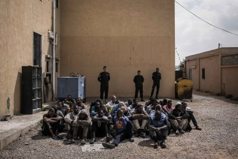 March 2017- Men detained in Janzour detention centre, on the outskirts of Tripoli, Libya. Detainees spend days and months in Libyan detention centres, without any idea when they will be released. Libya is a lawless state fragmented by conflicts, and both a destination and a place of transit for hundreds of thousands of refugees, asylum-seekers and migrants. In migrant detention centres, they face arbitrary detention for prolonged periods of time in unsanitary and inhumane conditions. There is no way to challenge the lawfulness of their detention, virtually no access to the outside world, habitual ill-treatment, and a lack of access to medical care.  Photograph: Guillaume Binet/ Myop/MSF