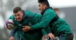 Denis Coulson and Bundee Aki taking part in a Connacht squad session at the Sportsground on Tuesday. Photograph: James Crombie/Inpho