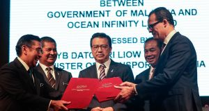 The signing ceremony between the Malaysian government and Ocean Infinity Limited at the Transport Ministry building, in Putrajaya, Malaysia on Wednesday. Photograph: Fazry Ismail/EPA