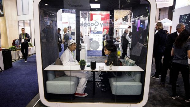 CES attendees sit inside a 'Hey Google' room at the Tile booth at CES Photograph: Bloomberg