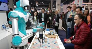 A man plays a game with a robot from Industrial Technology Research Institute on opening day at the 2018 International Consumer Electronics Show in Las Vegas. Photograph: Larry Smith/EPA