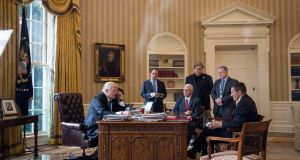 Call security: US president Donald Trump in the Oval Office with Reince Priebus, Mike Pence, Steve Bannon, Sean Spicer and Michael Flynn. Photograph: Drew Angerer/Getty