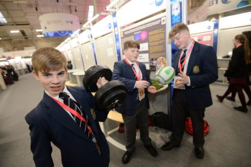 From left: Conor Madden, Pierce Scully and Finn Cowhig, Presentation College, Cork, with a project on what extent do young teenagers modify their diet in competitive level sports, at the BT Young Scientist & Technology exhibition, in the RDS, Dublin. Photograph: Dara Mac Donaill/The Irish Times