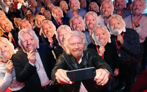 Richard Branson surrounded by staff wearing masks takes a selfie at Virgin Media's Business Brainstorm in Virgin Media Ireland's HQ in East Point Business Park, Dublin 3. Photograph: Julien Behal