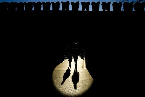 People walk through a portal of the Kremlin wall on a sunny winter day in Moscow. Photograph: Kirill Kudryavtsev/AFP/Getty Images