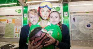Sam Hendrick (left) and Elle MacHale from Sutton park school with exhibit 'Investigating the forces transmitted when heading a football' during the BT Young Scientist and Technology Exhibition at the RDS ,Dublin. Photograph: Gareth Chaney/Collins
