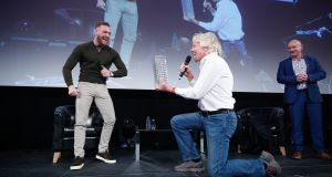 Pendulum Summit 2018 keynote speaker Sir Richard Branson with UFC Fighter Conor McGregor and MC Alan Shortt on the main stage of the Convention Centre in Dublin.  Photograph:  McCabe Photography.