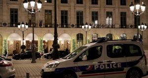 Police car parked outside the Ritz luxury hotel in Pari after an armed robbery on Wednesday. Photograph: Samson Thomas/Afp/Getty Images