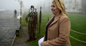 The new Secretary of State for Northern Ireland, Karen Bradley, walks past a statue of Charlie Chaplin before giving a press conference in Belfast on her first visit to the North. Clodagh Kilcoyne/Reuters
