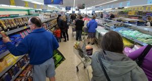 Shoppers at the Aldi store in Sallynoggin, Co Dublin. The company has accused its rivals of using planning 'obstruction' to deny consumers choice and market share. Photograph: Alan Betson