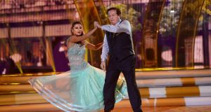 Marty Morrissey with Ksenia Zsikhotska dancing the quickstep. Photograph: Cyril Byrne