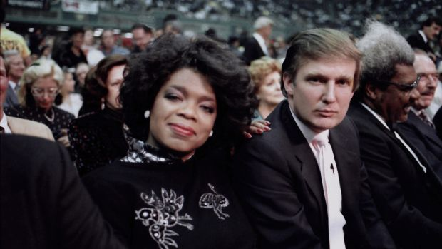 Donald Trump and Winfrey ringside at Mike Tyson vs Michael Spinks boxing match in Atlantic City, New Jersey, 1988. Photograph: Jeffrey Asher/ Getty Images