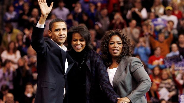 Barack Obama with his wife, Michelle, and host Oprah Winfrey at a campaign rally in 2007. Photograph: Brian Snyder/File Photo/Reuters