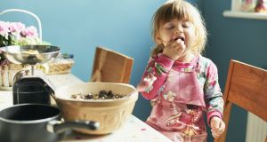 Teaching children to cook is a way of sparking an interest in healthy eating. Photograph: Getty Images