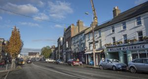 Naas's Main Street. The town, which has a population of 20,000-plus, retains a village vibe despite its size and range of facilities. Photograph: Brenda Fitzsimons