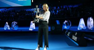 Maria Sharapova of Russia arrives on court with the the Daphne Akhurst Trophy during the 2018 Australian Open Official Draw at Melbourne Park. Photo: Scott Barbour/Getty Images