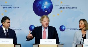 Britain's foreign secretary Boris Johnson speaks alongside  German foreign minister Sigmar Gabriel and the EU's foreign policy chief Federica Mogherini on the Iran nuclear deal, in Brussels on Thursday. Photograph: Francois Lenoir/Reuters