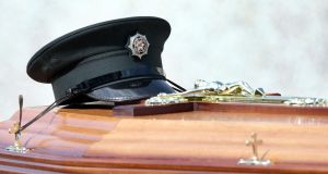 PSNI constable Ronan Kerr's hat rests on his coffin at his funeral in 2011 after he was targeted and killed by dissidents. File photograph: Paul Faith/PA Wire