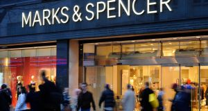 The FTSE 100 touched a fresh record and ended 0.2 per cent higher, despite falls for UK retailers Tesco and Marks & Spencer after their Christmas trading updates disappointed.