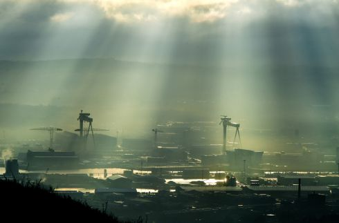 IN A FOG: The famous Harland and Wolff cranes peer through the fog in Belfast. Photograph: Charles McQuillan/Getty Images