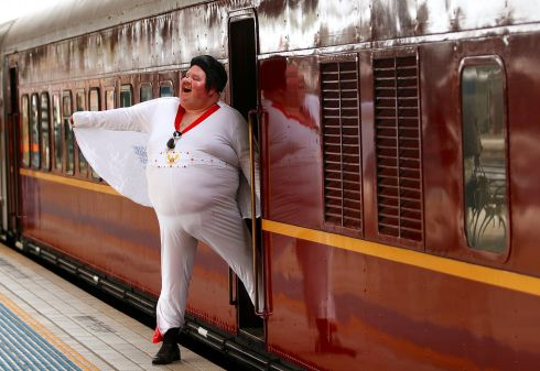 ONE TRACK HEART: Elvis Presley impersonator Sean Wright poses next to a train in Sydney before it departs for the 26th annual Elvis Festival in Parkes, in Australia. Photograph: Daniel Munoz/Reuters