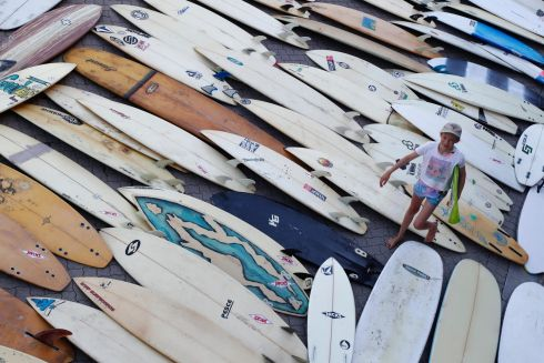 CHARITY BOARDS: A volunteer helps offload a container of over 700 surfboards donated by US surfers for children in Africa, as the boards arrive in Cape Town, South Africa. Photograph: Nic Bothma/EPA