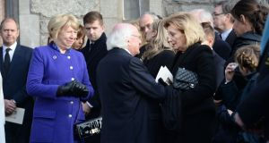 President Micheal D Higgins and his wife, Sabina, sympathising with Peter Sutherland's wife,  Maruja,  at his funeral in the Church of the Sacred Heart, Donnybrook. Photograph: Cyril Byrne